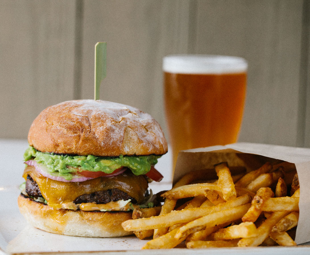 photo of a burger, fries, and a beer